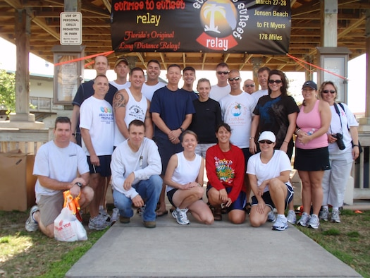 The members of the 45th Weather Squadron before the start of the Sunrise to Sunset Relay, a 178 mile marathon from Jensen Beach to Fort Myers, Fla., March 27. (U.S. Air Force photo courtesy of Staff Sgt. Carrie Volpe)