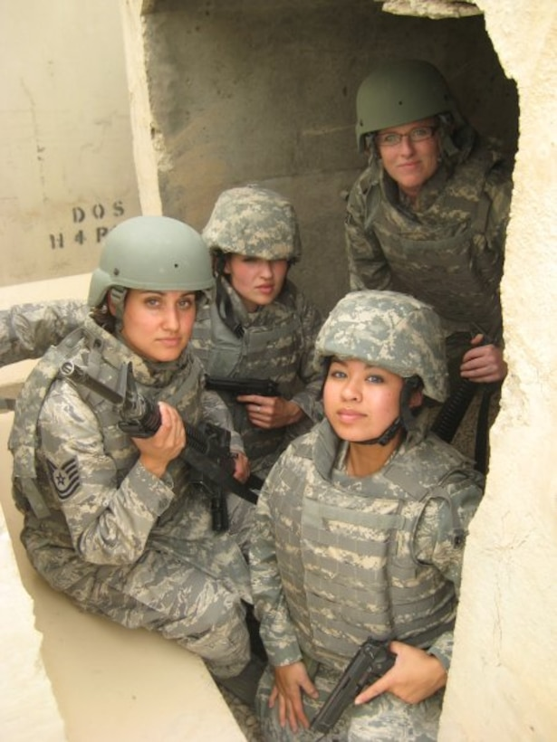 (From the left) Tech. Sgt. Chandra Smith, Capt. Darci Day, 1st Lt. Rhoda Alzo and Tech. Sgt. Bridgette Johnson sit in a Bagram Air Base bunker in Afghanistan. The Tops in Blue team members visited virtually every U.S. air base around the world. (Courtesy photo)