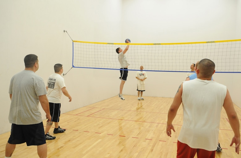 BUCKLEY AIR FORCE BASE,  Colo -- Members of the 460th Contracting Squadron play in a match against the 566th Intelligence Squadron en route to back-to-back wallyball championships, March 27. The Fitness Center hosts monthly lunchtime tournaments to promote fitness and esprit de corps for the troops on base. (U.S. Air Force Photo by Senior Airman Christopher Bush)