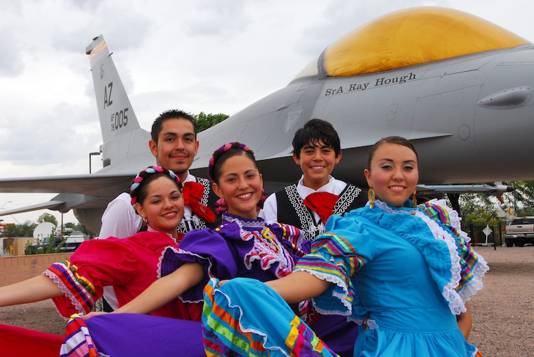 Tucson's Ballet Folklorico Los Mextucaz, take a souvenir photo in front of an F-16 static display at the 162nd Fighter Wing at Tucson International Airport. The dance team demonstrated Mexican folk dancing at the wing to celebrate Hispanic Heritage month, Oct. 3, 2008. (Air National Guard photo by Master Sgt. Dave Neve)