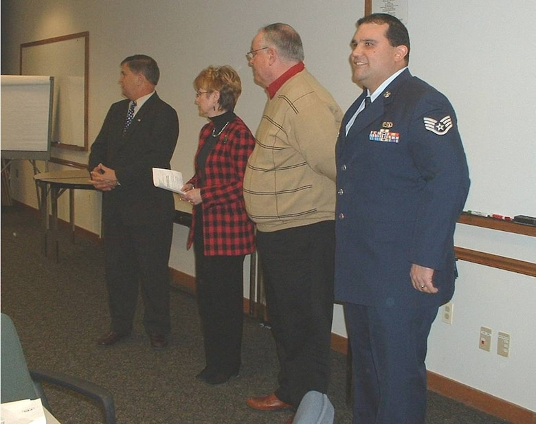 Earl Bonett, MA ESGR Area Chair and Ombudsman Director, Claude Waterman, Vice President of Human Resources, Thomas J. Moran, President & CEO, and SSgt Victor Rolon.