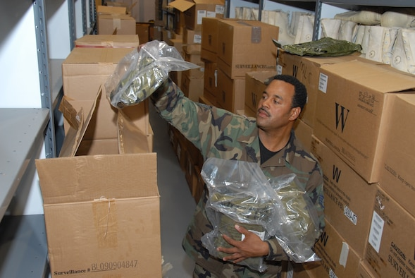 Staff Sgt. Tevis Williams unloads new JLIST chemical warfare suits for distribution at the 127th Mission Support Group Mobility Processing Center. The new suits are lighter and cleaner than the previous suits. U.S. Air Force photo by Master Sgt. Clarence Pence.