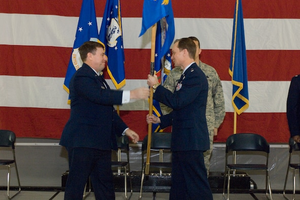 Brig. Gen. Michael Peplinski hands the 127th Maintenance Group Flag to Lt. Col. Gregory S. Holzhei during an April 4, 2009, assumption of command ceremony at Selfridge Air National Guard Base, Mich. Peplinski is the commander of the 127th Wing. Holzhei had recently been serving as the deputy commander for maintenance in the 127th Air Refueling Group, which is also at Selfridge. (U.S. Air Force photo by SrA. Jeremy Brownfield)