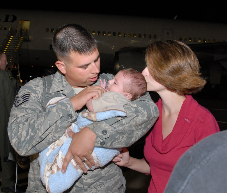 Staff Sgt. Norman E. Bauer Jr., 111th Maintenance Sq., is met by wife Bethany and son Matthew upon returning to Willow Grove ARS, Pa. from a deployment to Afghanistan on Sept. 20.