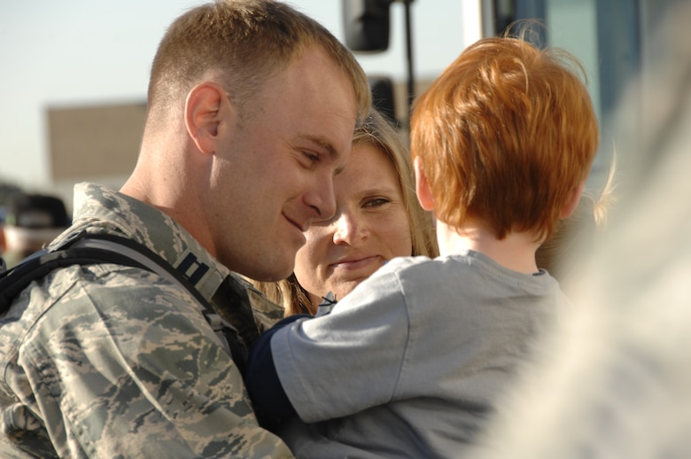 Capt. Robert Effler reunites with his family at the 129th Rescue Wing, Moffett Federal Airfield, Calif., April 6 after a three month deployment to Djibouti. Captain Effler is a combat rescue officer with the 131st Rescue Squadron. (U.S. Air Force photo by Tech. Sgt. Ray Aquino)