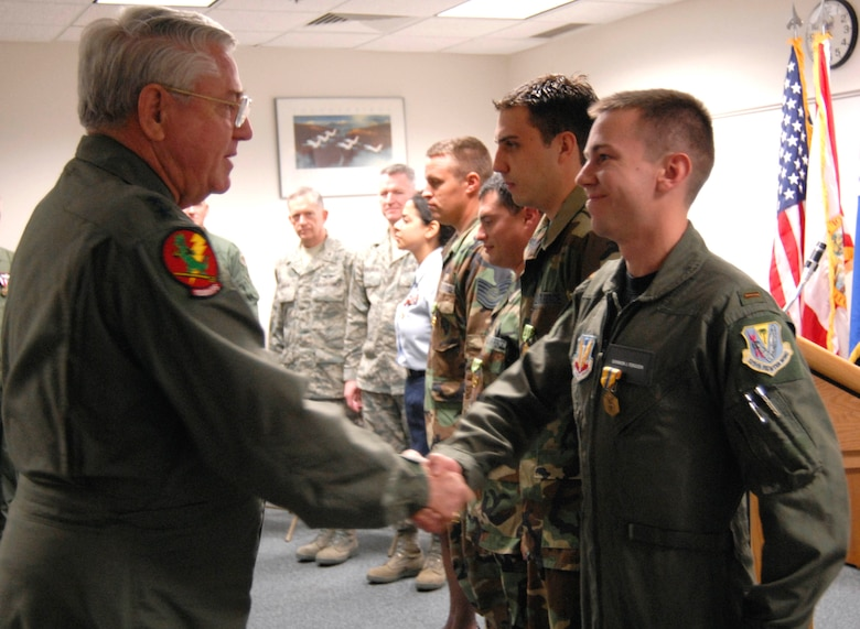 The Adjutant General of Florida Maj. Gen. Douglas Burnett (left) congratulates 2nd Lt. Brannon Ferguson of the Det. 1, 125th Fighter Wing, after presenting him with the Air Force Commendation Medal at the Homestead Air Reserve Base, Feb. 6, 2009.  The Adjutant General was at the base presenting awards and congratulating the unit on success during a recent inspection.