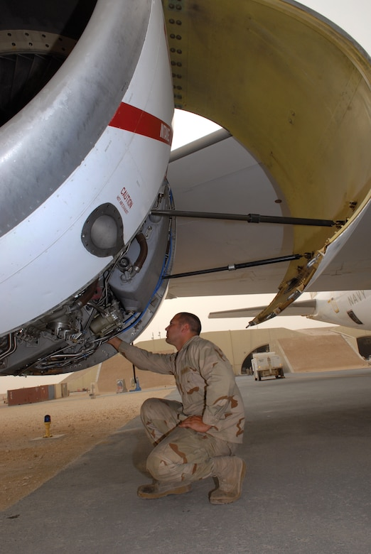 Petty Officer 3rd Class Zach Burghy, TF-124 aviation machinist, checks the oil level of one of the E-6B Mercury jet engine after a mission, April 1, 2009, at an undisclosed location in Southwest Asia. Petty Officer Burghy hails from Livingston, Wis. and is deployed from Tinker Air Force Base, Okla., in support of Operations Iraqi and Enduring Freedom and Combined Joint Task Force - Horn of Africa. (U.S. Air Force photo by Senior Airman Andrew Satran/Released)