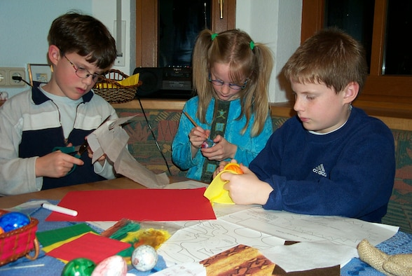 BINSFELD, Germany -- German children decorate Easter eggs. Although the origin of the Easter egg is not fully known it has become a main feature of the holiday. The tradition of the Easter Rabbit hiding the eggs traces to the year 1682. (Photo by Iris Reiff)