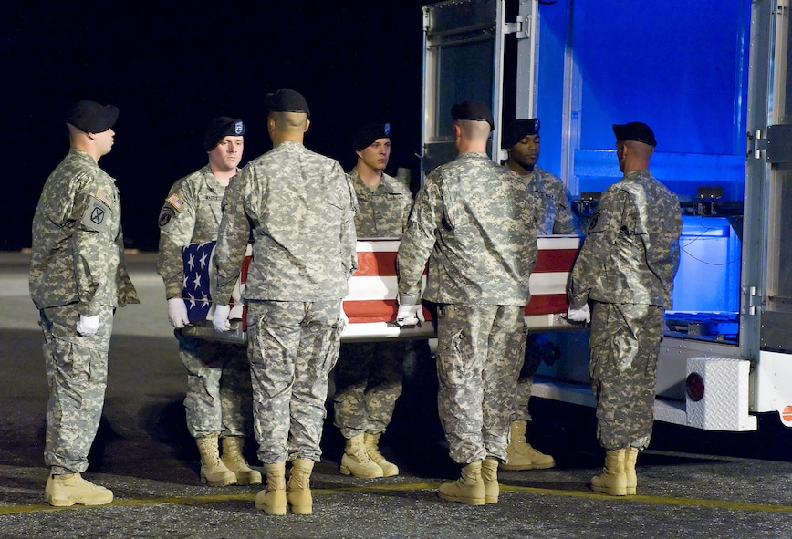 An Army carry team transfers the remains of Army Spc. Israel Candelaria Mejias, of San Lorenzo, Puerto Rico, at Dover Air Force Base, Del., April 7. Specialist Candelaria Mejias died April 5 near Baghdad, Iraq, of wounds sustained when a mine detonated near him during combat operations. He was assigned to the 1st Battalion, 2nd Infantry Regiment in Task Force 3rd Battalion, 66th Armor Regiment, 172nd Brigade Combat Team, Grafenwoehr, Germany. (U.S. Air Force photo/Roland Balik)
