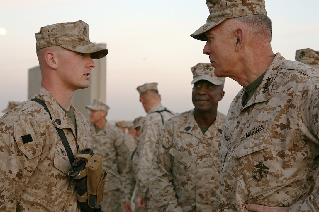 Sergeant Dustin H. Bowman, the current operations manager with Regimental Combat Team 8, greets the Commandant of the Marine Corps, General James T. Conway and the Sergeant Major of the Marine Corps, Sgt. Maj. Carlton W. Kent at the dining facility, Camp Ripper, Iraq. The Commandant of the Marine Corps and the Sergeant Major of the Marine Corps have been visiting forward operating bases throughout Multi National Force-West and took time out of their schedule to have dinner with RCT-8 Marines.