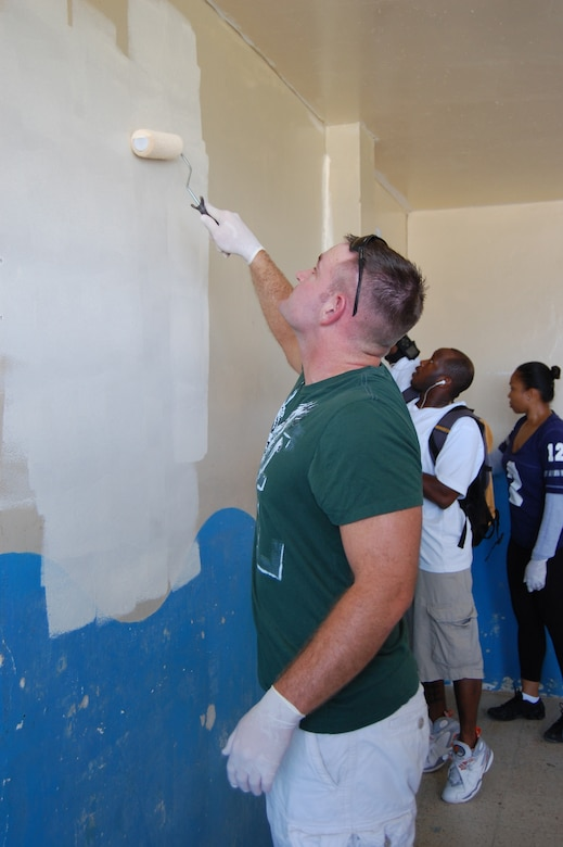Capt. Darren Stastny (left), chief of security forces for the 478th Expeditionary Operations Squadron, paints the interior of the Urbirios community kitchen in Manta, Ecuador March 20. Through the $7,000-worth of donated equipment from U.S. Southern Command's Humanitarian Assistance Program (HAP), the kitchen may now open its doors to serve more members of the community better quality and portions of food. (U.S. Air Force photo by 1st Lt. Beth Woodward)