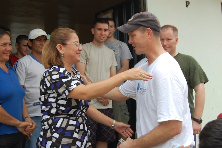 Ms. Asunción Barreto, a licensed social worker who runs the Urbirios community kitchen in Manta, Ecuador, thanks 478th Expeditionary Operations Squadron Commander, Lt. Col. Jared Curtis, after a day of painting March 21. Through the $7,000-worth of donated equipment from U.S. Southern Command's Humanitarian Assistance Program (HAP), the kitchen may now open its doors to serve more members of the community better quality and portions of food. (U.S. Air Force photo by 1st Lt. Beth Woodward)