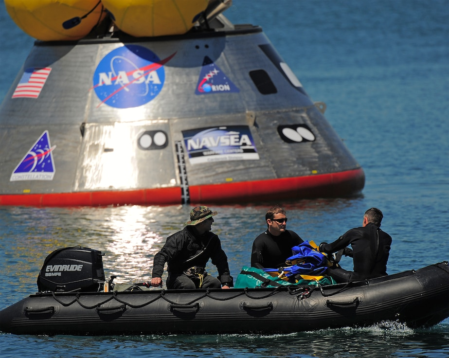 CAPE CANAVERAL AIR FORCE STATION, Fla. – Pararescuemen from the Air Force Reserve's 920th Rescue Wing prepare to deploy an inflatable flotation collar during recovery testing on a mockup of the Orion crew exploration vehicle at the Trident Basin at Port Canaveral, Fla., Mar. 8. The collar is designed both to stabilize the capsule after water landing and provide a platform for recovery personnel to stand on during the operation. Orion is targeted to begin carrying humans to the International Space Station in 2015 and to the moon by 2020. Orion is part of the NASA's Constellation Program. Reservists from the 920th provide contingency medical and recovery support for all NASA shuttle launches. The unit's primary mission is combat search and rescue. (U.S. Air Force photo/Tech. Sgt. Paul Flipse)