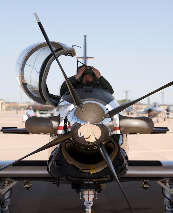 Maj. Gen. Gregory Feest, 19th Air Force commander, prepares to egress a brand new T-6 Texan II April 7 at the 80th Flying Training Wing. The general and Col. David Petersen, 80th FTW commander, picked up the new trainer that morning at Hawker-Beechcraft in Wichita, Kans. (U.S. Air Force photo/Lt. Col. Ternell Washington)