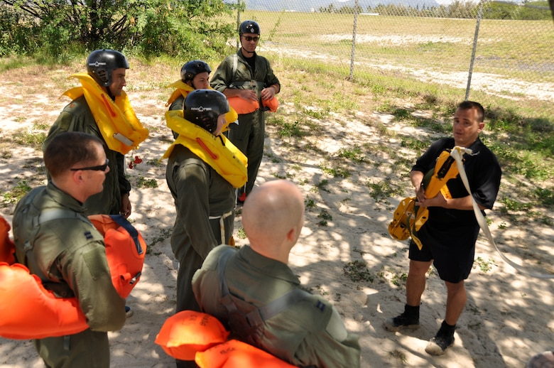 HICKAM AFB  -  U.S. Air Force SERE instructor Tech. SGt. Sherwood Brown prepares members of the Hickam AFB, Hawaii flying community for refresher water survival training on April 6, 2009. (U.S.  Air Force photo/Tech Sgt. Cohen A. Young)