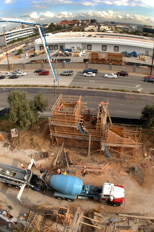 Work continues on the pedestrian bridge that will link Los Angeles Air Force Base with The Aerospace Corporation's office area.  The bridge, spanning El Segundo Boulevard, is expected to be complete in September.  (Photo by Mike Morales, The Aerospace Corporation)