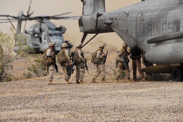 Marines with 3rd Battalion, 9th Marine Regiment, board a CH-53E Super Stallion after securing a landing zone on an Army Yuma Proving Ground range in Yuma, Ariz., as part of a Weapons and Tactics Instructor course April 13, 2009. The battalion is training for its deployment in August 2009. The Camp Lejeune, N.C., battalion is scheduled to conclude their training in Yuma with a battalion-sized helicopter-borne assault exercise in late April, the largest exercise of its type conducted in approximately 10 years.