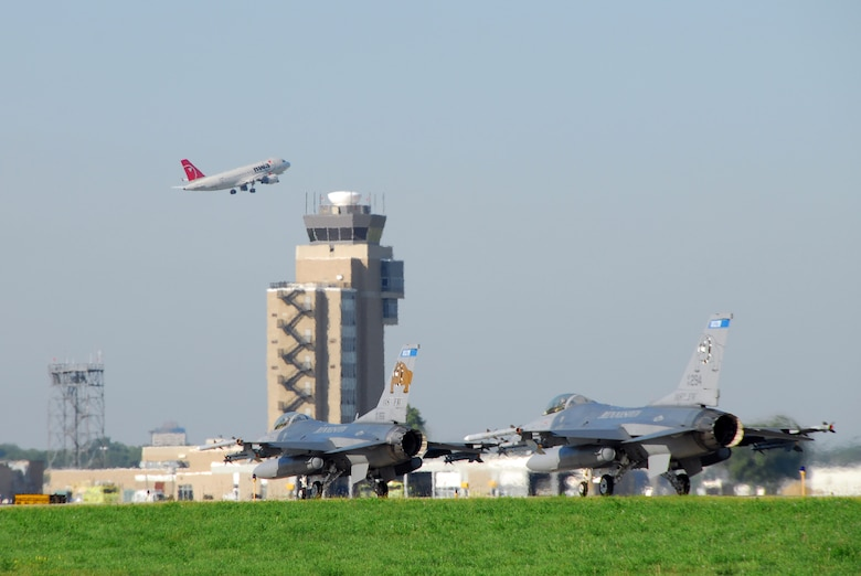 Two F-16C Fighting Falcons of the 148th Fighter Wing, Duluth, Minn. Air National Guard Base, taxi to the runway at the Minneapolis International Airport, Minn. Sept. 5, 2009.  The 148th performed Air Sovereignty Alert missions for the Republican National Convention from both Duluth and Minneapolis. (U.S. Air Force photo by Tech. Sgt. Jason W. Rolfe)