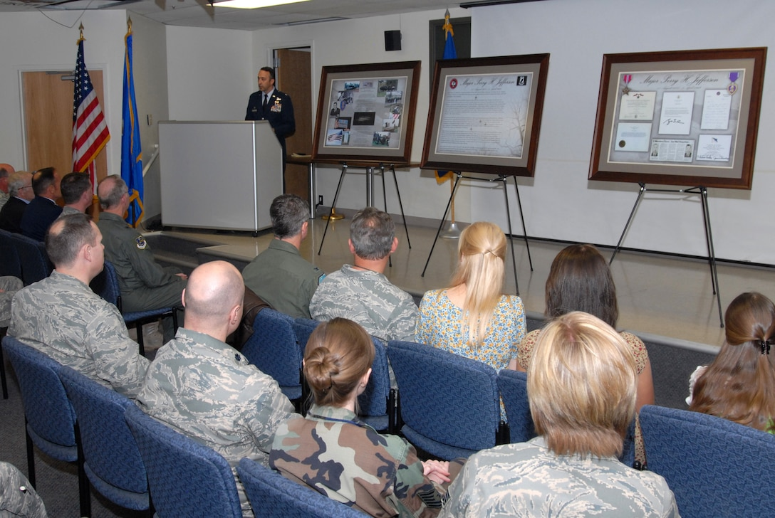 LtCol Timothy Conklin speaks to audience members during an auditorium dedication ceremony.  Audience members in attendance have come from as far away as Colorado and Washington DC to honor Major Jefferson.  This auditorium will be visited by nearly every Air Force and Air National Guard Intel airman as they enter thier training into their career field.