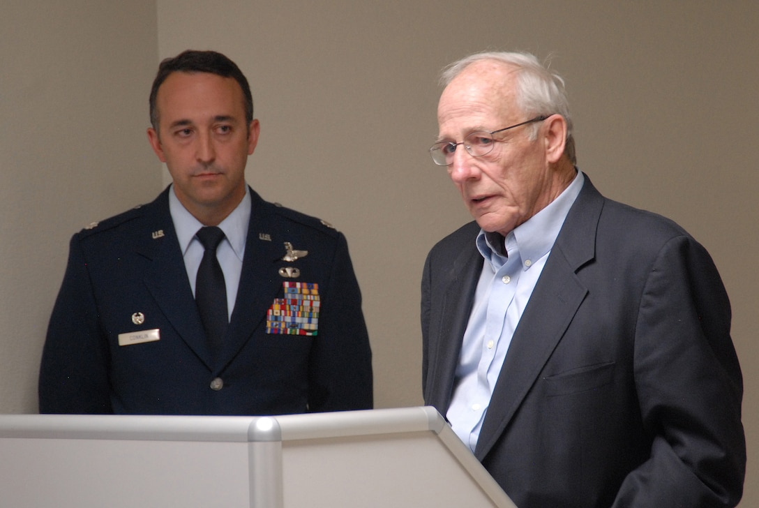 Mr. Mike Jefferson speaks during a dedication ceremony for his brother, Major Perry Jefferson as LtCol Timothy Conklin looks on.