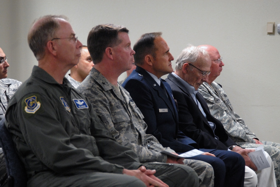 Military members and brother of Major Perry Jefferson, Mr. Mike  Jefferson, attend the Intel Auditorium dedication ceremony.
