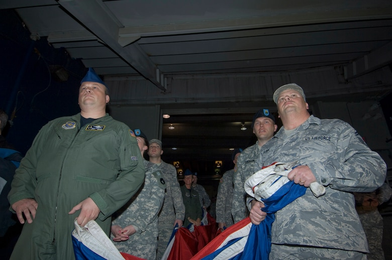 Minnesota National Guard Airmen and Soldiers wait in a tunnel of the Hubert H. Humphrey Metrodome with a giant American flag to used for the national anthem in the home opener for the Minnesota Twins on April 6, 2009. For Master Sgt. Rick Krivanek of the 109th Airlift Squadron (left), and Senior Master Sgt. Dan Flohr (right) of the 210th Engineering and Installation Squadron, it is thier 6th time on the field to participate in the honors. USAF Official Photo by Senior Master Sgt. Mark Moss