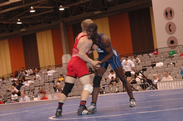 Airman Kevin Justin, 96 Security Forces Squadron, Eglin Air Force Base, clinches with one of his opponents during the FILA Junior National Wrestling tournament April 8 in Las Vegas.