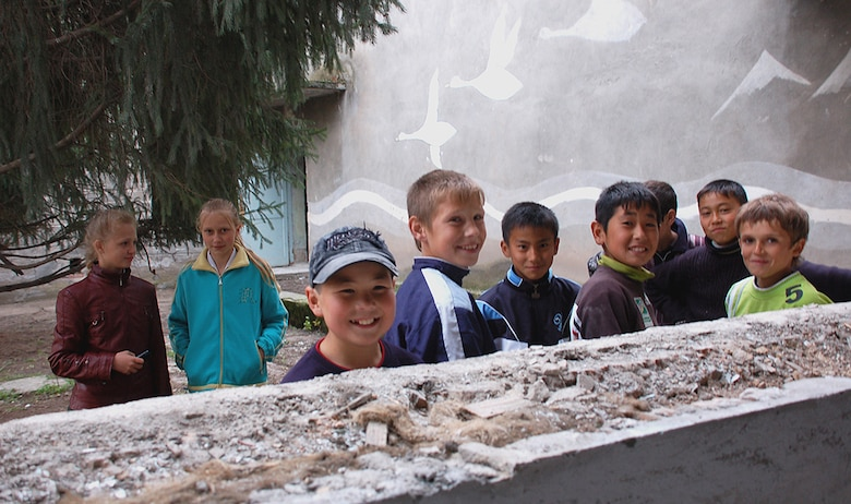 Children of the Birdik Village School in Kyrgyzstan are all smiles after a ground breaking ceremony for a $470,000 project to repair the school. The project is a joint effort between the U.S. State Department, U.S. Central Command, Manas Air Base and Birdik Village, and is scheduled to completed in Autumn 2009. When finished, the newly renovated school will house 200 students. (U.S. Air Force photo/Tech. Sgt. Phyllis Hanson)