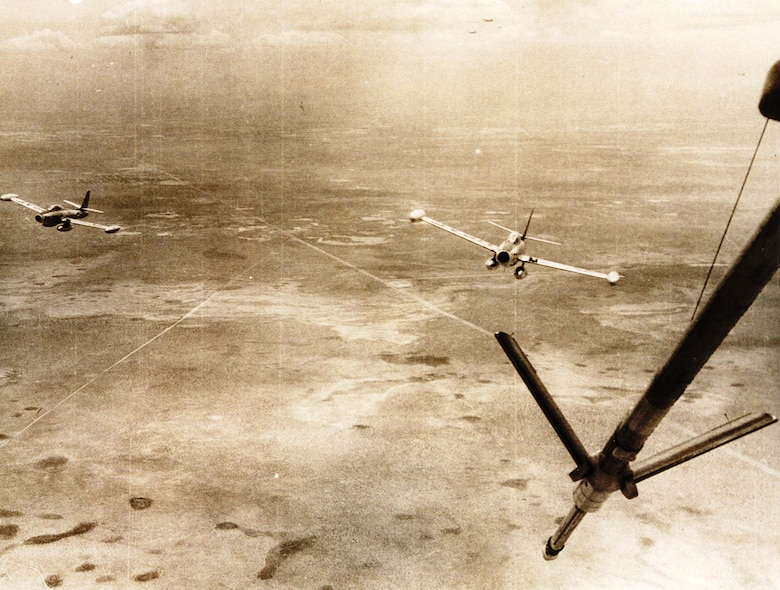 High over West Texas, two F-84Gs of the 31st Fighter Escort Wing pull in behind a waiting KB-29P during Operation Fox Peter One. (U.S. Air Force historical photo)