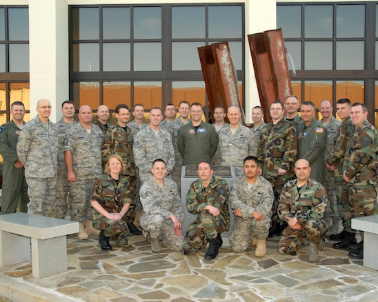 The 101st Information Warfare Flight from the Utah Air National Guard takes a group photo in front of the 601st Air and Space Operations Center at Tyndall Air Force Base, Fla. on March 4, 2009.  The 101st IWF traveled to Tyndall for their annual training to hear mission briefings and tour the AOC.  U.S. Air Force Photo by: Staff Sgt. Emily Monson (RELEASED)