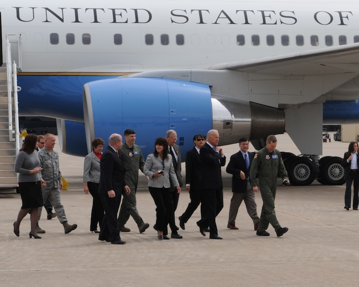 WHITEMAN AIR FORCE BASE, Mo. - Vice President Joe Biden walks from Air Force Two escorted by Col. Robert Wheeler, 509th Bomb Wing commander, and Col. John Robinson, 509th BW vice commander, toward hanger T-9 April 16 where a rally for the troops is being held. Mr. Biden later visited Jefferson City and the University of Missouri-St. Louis to highlight progress of the Recovery Act. (U.S. Air Force Photo by Airman 1st Class Carlin Leslie)