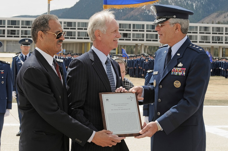 "Air Force Academy Superintendent Lt. Gen. John F. Regni presents the 2009 Col. James Jabara award to 1973 graduate and classmate Chesley ""Sully"" Sullenberger during a parade held in his honor April 15. Assisting is William ""T"" Thompson, chief executive officer for the Association of Graduates. Capt. Sullenberger received the award for displaying extraordinary Airmanship in hazardous conditions by landing the crippled U.S. Airways Flight 1549 in the Hudson River Jan. 15. (U.S. Air Force photo/ Mike Kaplan)"
