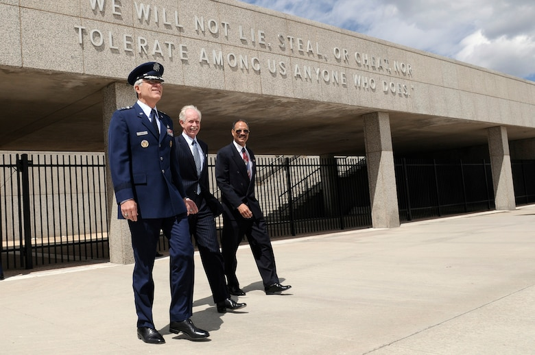 "Air Force Academy Superintendent Lt. Gen. John F. Regni is accompanied onto the  Academy Terrazzo by classmate Chesley ""Sully"" Sullenberger, recipient of the 2009 Col. James Jabara Award for Airmanship, and William ""T"" Thompson, chief executive officer for the Association of Graduates (U.S. Air Force photo/Mike Kaplan)"