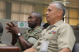 Brigadier Gen. Ronald L. Bailey (left), co-director, Balikatan '09, and AFP Commodore Ramon P. Espera Jr., RP Balikatan '09 exercise director, listen attentively during the first bilateral Balikatan 2009 commander's brief at the Command and General Staff College here April 20. Photo by Lance Cpl. Cristina Gil