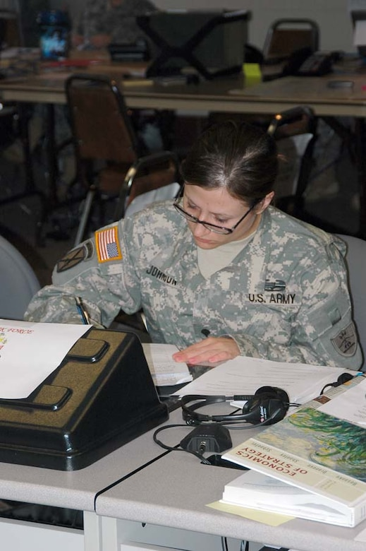 Spc. Danielle Y. Johnson, a member of the 1-188th Air Defense Artillery, studies during down time at the Grand Forks Armed Forces Reserve Center. Johnson is a political science major at North Dakota State University in Fargo, N.D.