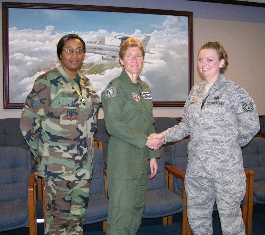 552nd Air Control Wing Commander Col. Pat Hoffman congratulates Tech. Sgt. Ashley Kimbrough on her certification as an Emergency Actions Controller for the 