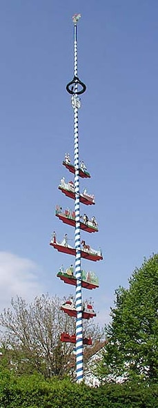 MARKTL, Bavaria -- This blue and white striped May pole in Marktl, Bavaria is a typical example of a Bavarian May tree. A May pole is a wooden pole made from a tree trunk of pine or birch, typically decorated with colorful ribbons, flowers, carved figures and various other decorations, depending on regional tradition. (Courtesy photo)