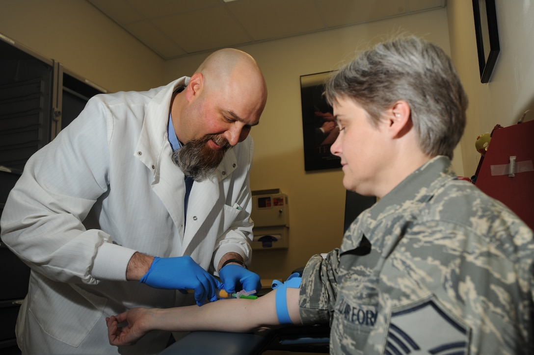 ELMENDORF AIR FORCE BASE, Alaska-- Mike Bush of 3 Medical Support Squadron (3MDSS) gives Master Sgt. Susan Andersen, also from 3 MDSS, a blood test April 15, 2009. Blood tests are used for an abundance of purposes and are very critical to our health. (U.S. Air Force photo by Airman First Class Kristin High)
