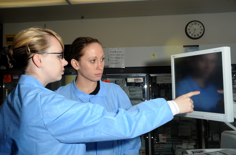 ELMENDORF AIR FORCE BASE, Alaska-- Senior Airman Leslie Balliew and Airman 1st Class Heather Long of 3 Medical Support Squadron examine test results on April 15, 2009. Lab technicians are vital to our health care, providing us critical information by detecting unknown health problems and aiding in the diagnosis and treatment of known conditions. (U.S. Air Force photo by Airman First Class Kristin High)