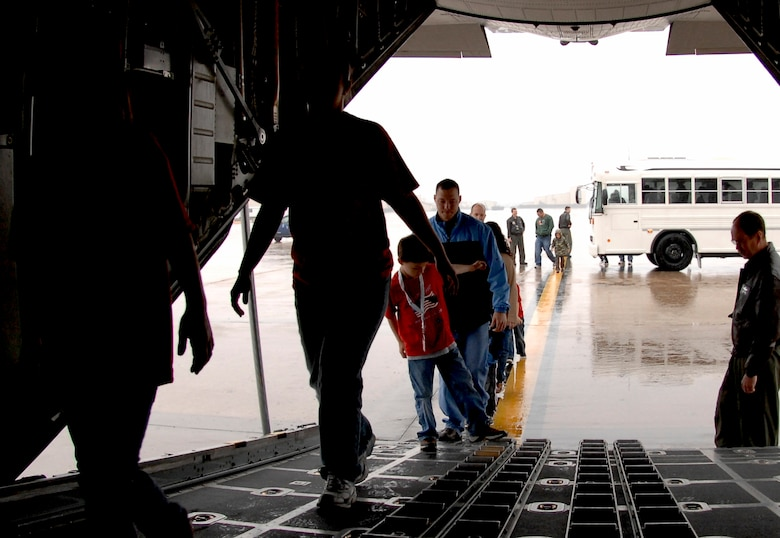 "WHITEMAN AIR FORCE BASE, Mo. - Young ""Airmen"" board a C-130 from the 139th Airlift Wing in St. Joseph, Mo. April 18 during Operation Spirit. Operation Spirit is a simulated deployment line for school-aged kids that allows children to experience what their military parents go through during a deployment. The ""Airmen"" were accompanied by their parents and received goodies form several base agencies. (U.S. Air Force photo/Staff Sgt. Jason Barebo)"
