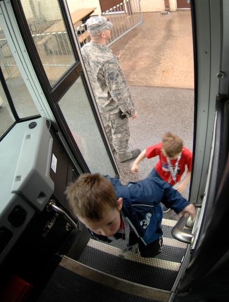 "WHITEMAN AIR FORCE BASE, Mo. - Young ""Airmen"" load onto a bus April 18 during Operation Spirit as they prepare to go to the flightline and board an awaiting C-130. The ""Airmen"" participated in a mock deployment to Kabul, Afghanistan. Operation Spirit is a simulated deployment line for school-aged kids that allows children to experience what their military parents go through during a deployment. The ""Airmen"" were accompanied by their parents and received goodies form several base agencies. (U.S. Air Force photo/Staff Sgt. Jason Barebo)"