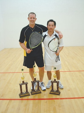 SCOTT AIR FORCE BASE, Ill. --Jerry Turley (left) won first place last week in the racquetball tournament held at James Gym.  Mr. Cheng won second place. (U.S. Air Force photo/Steve Berry)
