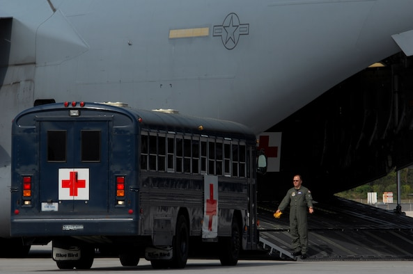 Medical busses from the 435th Contingency Aeromedical Staging Facility pull up to a C-17 Globemaster III in preparation to load patients April 21, 2009, Ramstein Air Base, Germany. Members from the CASF loaded several patients who were taken care of by members from the 86th Aeromedical Evacuation Squadron while being transported back to the continental United States for further treatment. (U.S. Air Force photo by Airman 1st Class Kenny Holston)