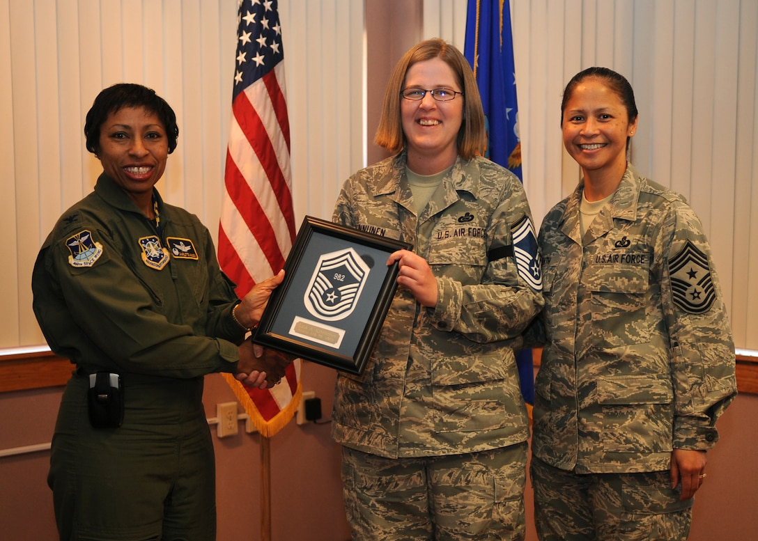 BUCKLEY AIR FORCE BASE, Colo. -- Master Sergeant Lisa Kinnunen is congratulated by Col. Charlotte Wilson, 460th Space Wing Vice Commander and 460th Space Wing Command Chief Master Sergeant Arleen Heath, for her selection to Senior Master Sergeant.   Sergeant Kinnunen was recently one of 1,450 master sergeants to receive the news and the only one at Buckley.  (U.S. Air Force photo by Senior Airman Randi Flaugh)