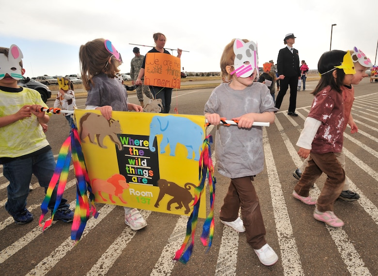BUCKLEY AIR FORCE BASE, Colo. -- Children, parents and staff from both Child Development Centers participated in the kickoff parade for the Month of the Military Child here, April 3.  Many of the children dressed up in masks and face paint to walk in the parade.  The month of April is dedicated to the more than $1.7 million American children under the age of 18 that have at least one parent serving in the military.  (U.S. Air Force photo by Senior Airman Alex Gochnour)