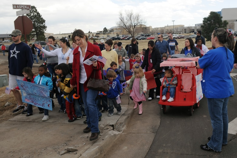 BUCKLEY AIR FORCE BASE, Colo. -- Children, parents and staff from both Child Development Centers participated in the kickoff parade for the Month of the Military Child here, April 3.  Many of the children dressed up in masks and face paint to walk in the parade.  The month of April is dedicated to the more than 1.7 million American children under the age of 18 that have at least one parent serving in the military.  (U.S. Air Force photo by Senior Airman John Easterling)