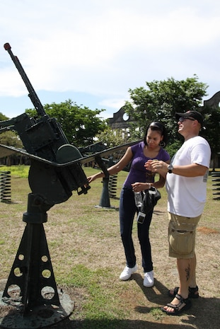 Gunnery Sgt. Bill Elver, postal operations staff noncommissioned officer, III MEF, explains parts of World War II-era weaponry to Lance Cpl. Tyrika Bradby, administration clerk, III MEF during a visit to the historical island of Corregidor Aril 25. Photo by Lance Cpl. Christina Noelia Gil