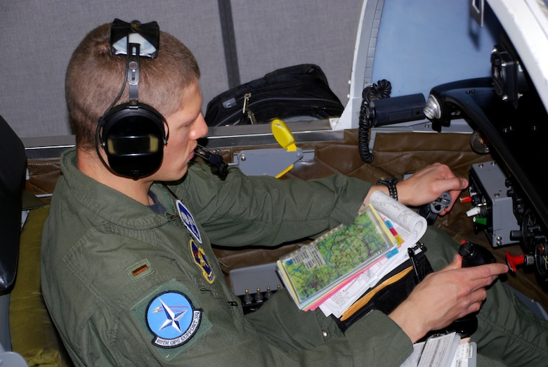 "Second Lt. Evan Negron, a T-37 Tweet student pilot in the Euro-NATO Joint Jet Pilot Training Program at Sheppard Air Force Base, Texas, ""flies"" the last simulation by a student pilot in the Air Force April 23. The T-6A Texan II will replace the Tweet this summer when the more than 50-year-old introductory trainer retires.  (U.S. Air Force photo/John Ingle)"