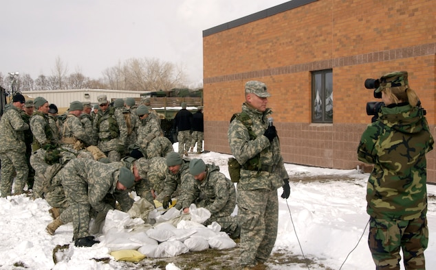"""27 March 2009Staff Sgt Amber Monio interviews Captain Charles Moore who finds his troops now not only helping the people of Moorhead Minnesota but also trying to keep the water out of the Armory. Over a hundred members of the Guard are currently calling the armory home sleeping on cots night and day while taking shifts to """"fight"""" the flood of 2009 in Moorhead.U.S. Air Force Photo by Tech Sgt Erik Gudmundson (Released)"""