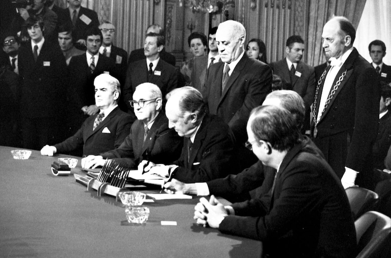 Signing the peace agreement, Paris, Jan. 27, 1973. (U.S. Air Force photo)